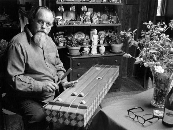 Lou Harrison playing one of his homemade instruments.