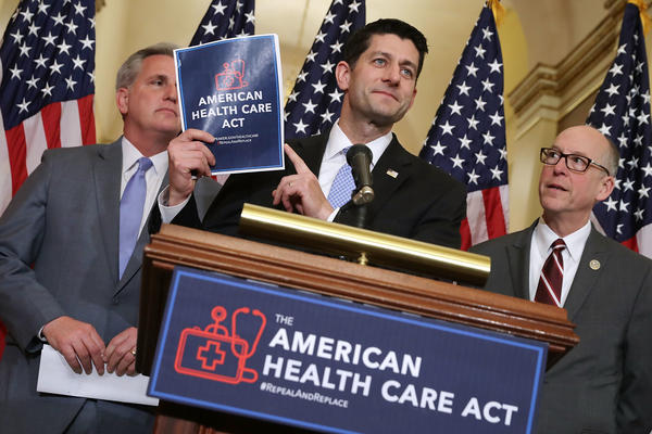 Speaker of the House Paul Ryan holds up a copy of the American Health Care Act during a March 7 news conference with House Majority Leader Kevin McCarthy, R-Calif. (left), and House Energy and Commerce Committee Chairman Greg Walden, R-Ore., outside Ryan's office in the Capitol.