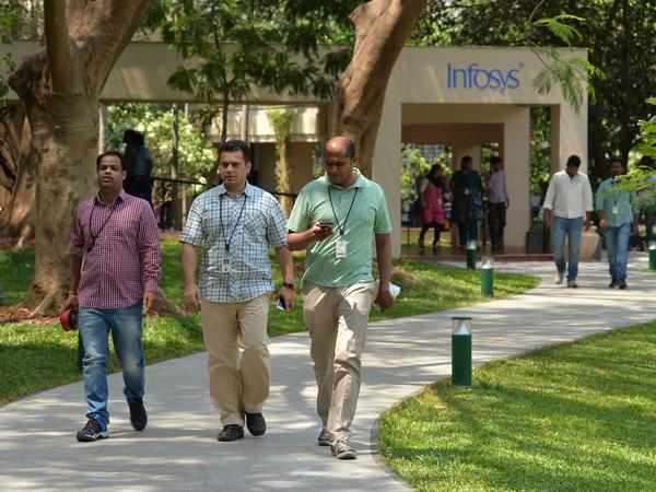 Employees of Infosys Technologies walk on the campus of the company's headquarters in Bangalore, India, on April 13.