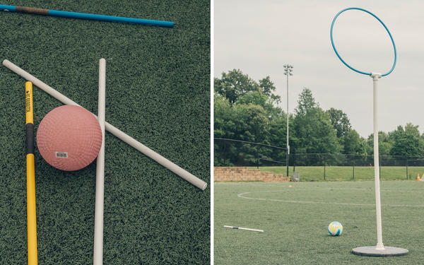 Quidditch's requisite sticks lie on a field, or pitch, next to a bludger, or a dodgeball in the real-life game. One of the scoring hoops — there are three — are set up on the pitch.