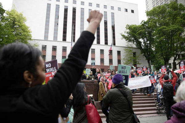 Protesters gather outside the 9th U.S. Circuit Court of Appeals in Seattle last month as judges prepare to hear arguments on the revised travel ban. This week, the Justice Department took its challenge to blocks on the ban to the U.S. Supreme Court.