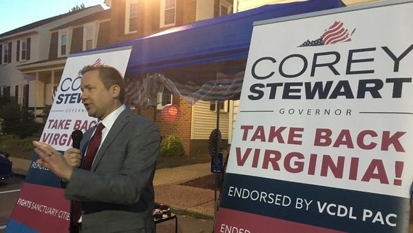 "Corey Stewart, seen at a campaign rally in Virginia Beach, Va., is appealing to supporters of President Trump on the campaign trail. ""Who's excited that we finally have a real president of the United States?"" he recently asked."