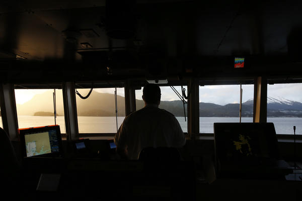 First Mate Aaron Isenhour steers the MV LeConte, a ferry heading from Haines, Alaska to the state capital, Juneau.