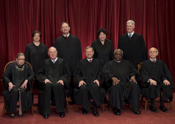 Justices of the Supreme Court sit for their official group photo in June 2017. Seated, from left: Ruth Bader Ginsburg, Kennedy, Chief Justice John G. Roberts, Clarence Thomas and Stephen Breyer. Standing:  Elena Kagan, Samuel Alito Jr., Sonia Sotomayor and Neil Gorsuch.