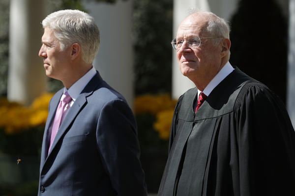 Kennedy (right) prepares to administer the judicial oath to Judge Neil Gorsuch during a ceremony in the Rose Garden at the White House in 2017.