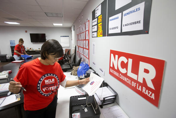 Canvasser Ana Mejia gathers her supplies at the offices of the National Council of La Raza in Miami in 2016. The NCLR renamed itself UnidosUS this month, causing a rift in the U.S. Latino community. Some see it as shedding a dated name, but others see it as leaving a legacy behind.