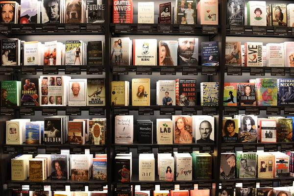 """Books at Amazon's New York City store are shelved with the covers facing out and organized around features that originated on the website, including """"Most Wished For"""" and """"Customers Who Bought This Item Also Bought."""""""