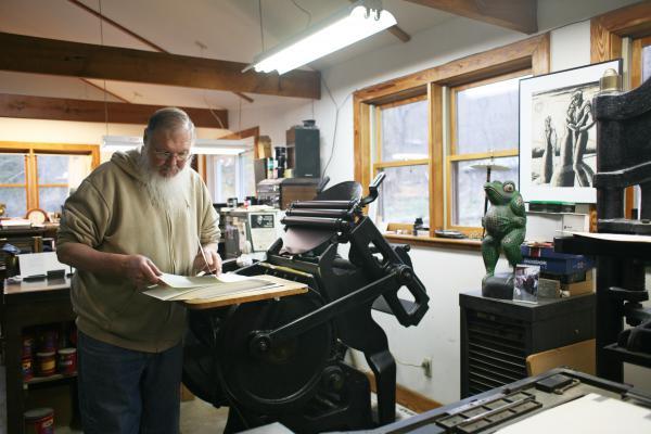 Gray Zeitz at his 1915 Chandler & Price printing press.