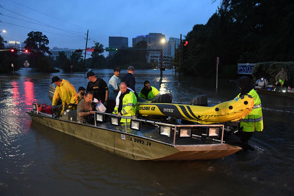 People are rescued from a hotel by boat after Hurricane Harvey caused heavy flooding in Houston on Sunday.