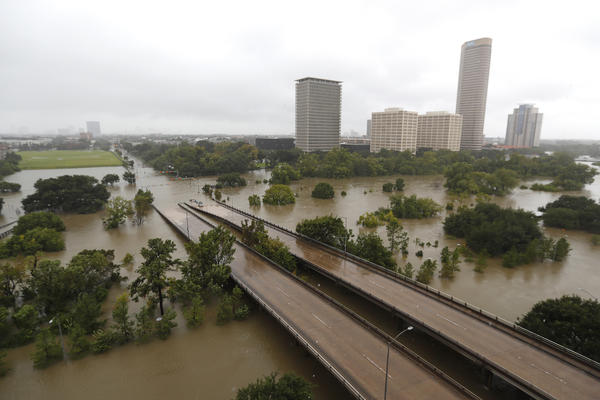 """Overhead view of the floods from Buffalo Bayou in Houston, <a href=""""http://www.chron.com/news/houston-weather/hurricaneharvey/article/Houston-hunkers-to-Harvey-braces-for-long-storm-12003388.php"""" target=""""_blank"""">as heavy rains continued falling</a> in the area."""