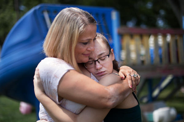 Destini Johnson gets a hug from her mother. She was released unexpectedly early because, she tells her parents, the jail was overcrowded.