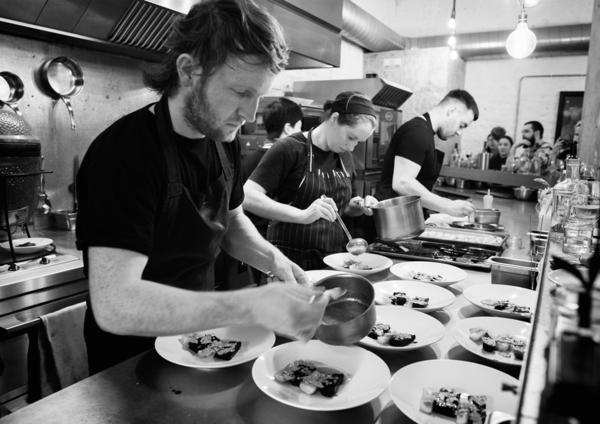 """Chef Douglas McMaster is committed to a """"zero waste"""" ethos in his restaurants. Here, he plates up his creations at Silo, his flagship restaurant, in Brighton, England, about an hour south of London."""