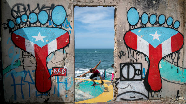 Skateboarders use an empty fish bowl in La Perla.