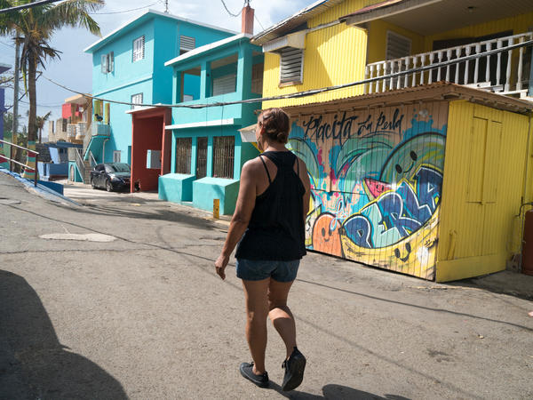 "Carmen Lourdes Lopez, 58, walks in the La Perla neighborhood. Over the summer, she was giving ""Despacito"" tours to people visiting Puerto Rico."