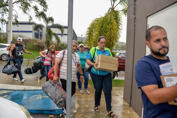 Volunteers helping transport medical supplies.