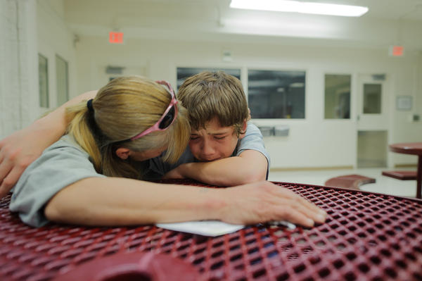 "Vinny, at age 13, cries during a visit with his mother, Eve, at the Bernalillo County Juvenile Detention Center in Albuquerque, New Mexico. ""Mom, just get me out,"" he says. Vinny was incarcerated for stabbing his mother's assailant: ""When my mom was being beat up, I was so scared. I wanted to defend my mom."""