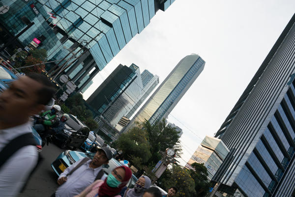 A busy sidewalk in Jakarta, Indonesia's capital. Indonesia's founding philosophy includes the notions of unity and social justice for all. But there are growing concerns that the country is becoming less tolerant than it once was.
