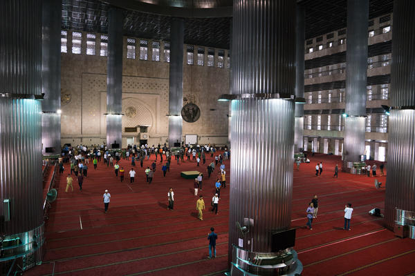 People leave the Istiqlal mosque after prayers. Istiqlal is the national mosque of Indonesia and was built in the 1970s to commemorate the country's independence.