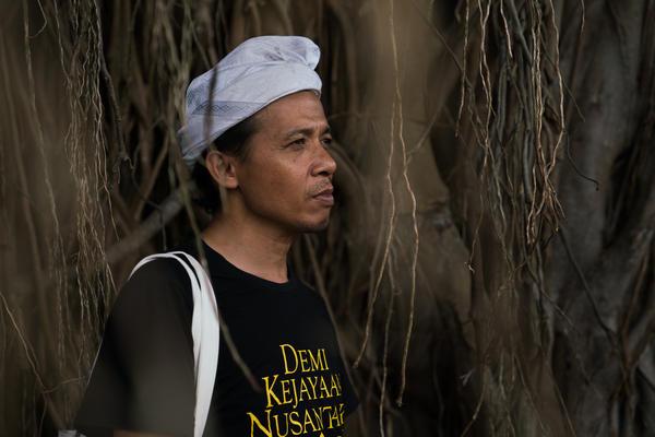 Wahjudi Djaja calls himself an ambassador of Kejawen religion. Standing in front of an old banyan tree, he says many spirits live in the tree.