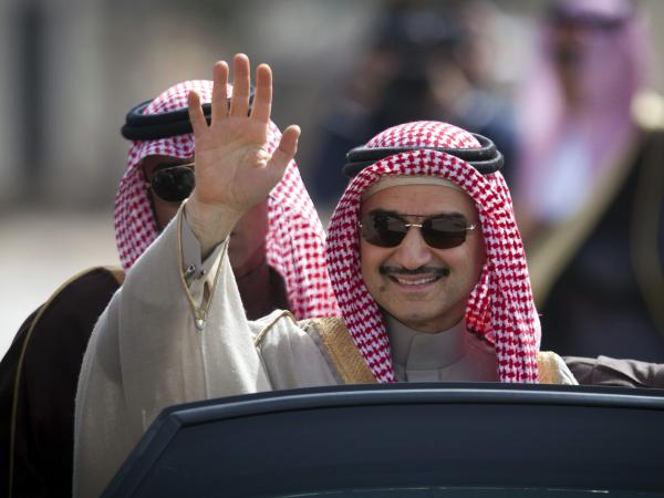 Saudi billionaire Prince Alwaleed bin Talal waves in the West Bank city of Ramallah in 2014. He is among dozens of Saudi princes and former government ministers arrested over the weekend as part of a sweeping anti-corruption probe, further cementing King Salman and his crown prince son's control of the kingdom.