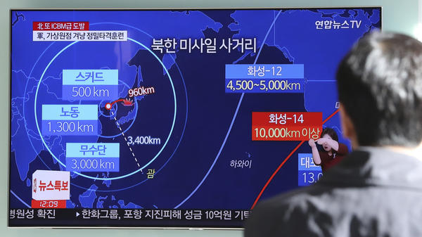A man in Seoul, South Korea, watches a local news report about North Korea's missile launch on Wednesday.