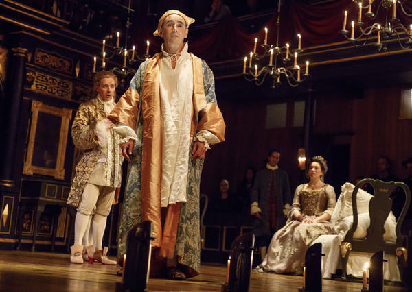 Mark Rylance (center) plays King Phillipe V in the new play <em>Farinelli And The King. </em>In this scene, opera star Iestyn Davies (left) plays the titular singer whose voice nurses the king back to health.