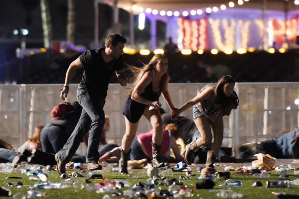Concertgoers flee gunfire at the Route 91 Harvest country music festival in Las Vegas on Oct. 1.