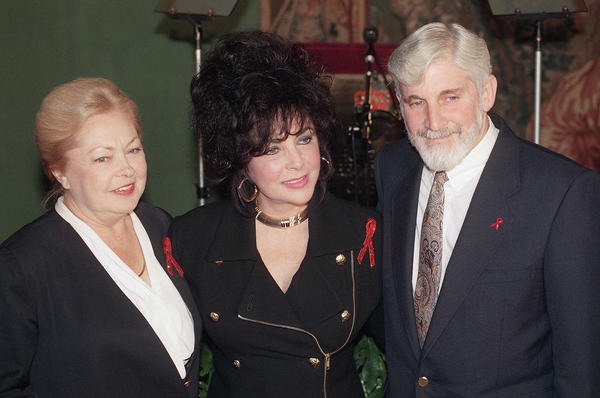 Mathilde Krim (left), shown here in 1992 with fellow amfAR board members Elizabeth Taylor and Dr. Mervyn F. Silverman, campaigned for needle exchange programs to stop the spread of HIV/AIDS among drug users, and promoted public campaigns that advocated safe sex practices, such as condom use.