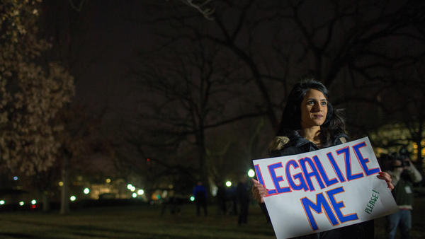 DACA supporters rally at the U.S. Capitol on Friday in Washington, D.C. Democrats, are pushing to include an immigration measure that would include a pathway to citizenship for roughly 700,000 immigrants enrolled in the Deferred Action for Childhood Arrivals.