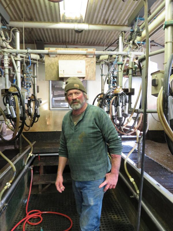 Farmer Will Rogers says he can no longer make ends meet milking the 75 cows on his dairy farm in Warren, Mass. Declining milk prices are taking a financial and emotional toll on dairy farmers, he says.