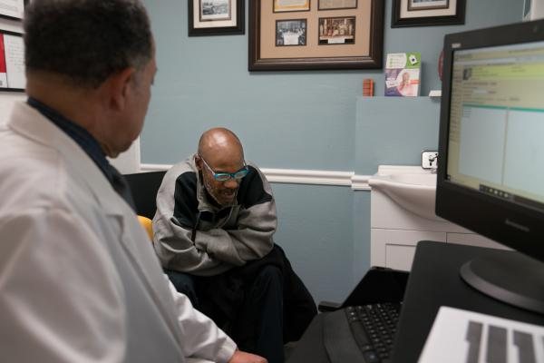 Norman Hughes talks with Dr. Chapman during an appointment.