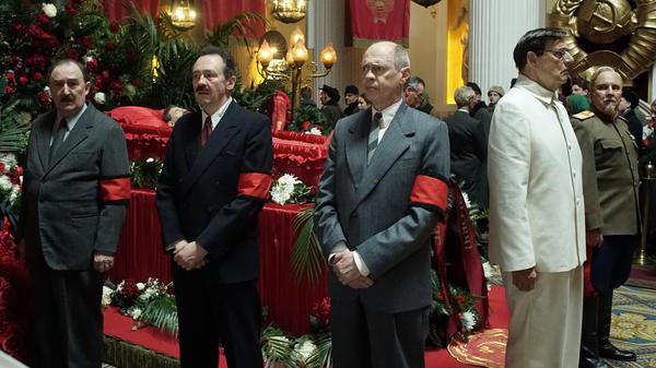 Stalin's Dead <em>and</em> Red in <em>The Death of Stalin</em>. L to R: Dermot Crowley as Kaganovich; Paul Whitehouse as Mikoyan; Steve Buscemi as Krushchev; Jeffrey Tambor as Malenkov; Paul Chahidi as Bulganin.