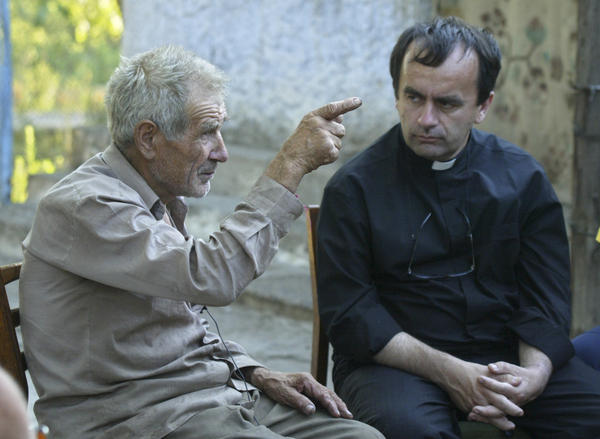 In 2007, Anatoly Veliminchuk (left) speaks with Desbois about the massacre of tens of thousands Jews he witnessed in the early years of World War II in Bogdanivka, Ukraine.