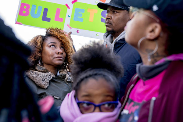 Taurica Haskins (left) is comforted by her husband, Alden Haskins Jr., as they arrive at the Washington rally. They were among those attending in memory of Jamahri Sydnor, 17, who was killed by a stray bullet in Washington, D.C., in August 2017.