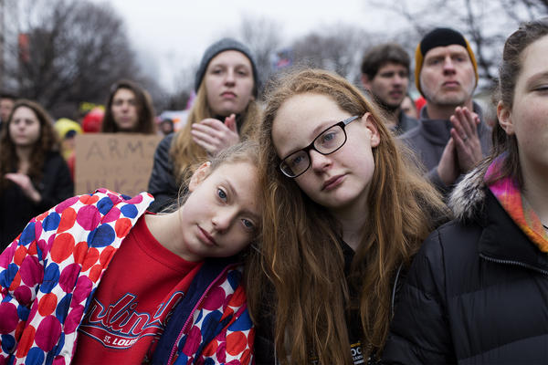 "Isabelle Braeske, 12, and Madelaine Province, 11, listen to ""March for Our Lives"" speakers after a march through downtown St. Louis."