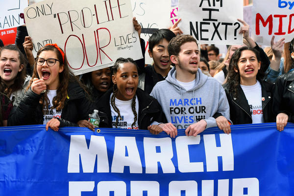 Students from all over Massachusetts and New England lead a large march down Columbus Avenue in Boston.