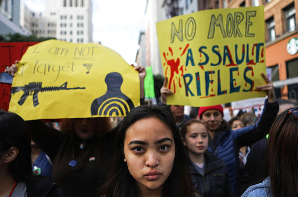 Young activists stand before marching during the March for Our Lives rally in Los Angeles, California.