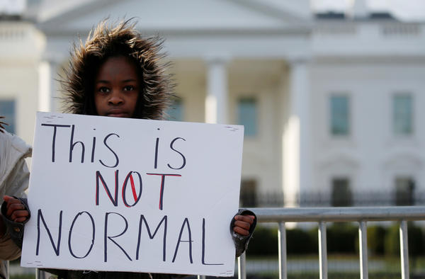 Kashyia Smith, 12, from Wisconsin, poses for a photo in front of the White House.