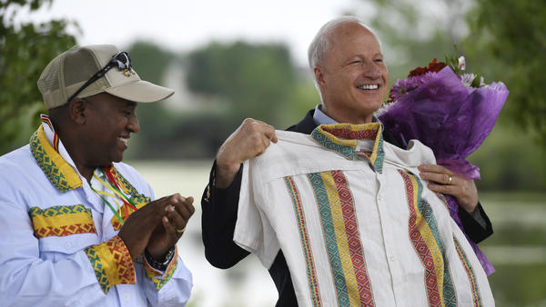 U.S. Rep. Mike Coffman, R-Colo., accepts a gift of a traditional Ethiopian shirt from Girum Alemayehu at an Ethiopian festival in Denver in August 2016. Coffman has survived multiple tough re-election campaigns in part due to his outreach to various immigrant communities in his district.