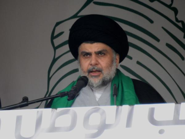 Iraqi Shiite cleric Muqtada al-Sadr addresses his supporters during a demonstration in Baghdad in 2017. He is now aligning himself with Communists ahead of Iraq's May election.