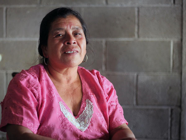Maria Lopez Santos sits in her home that was built using remittances from family members who worked as undocumented migrants in the U.S.