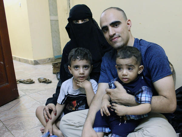 Amr Mozeb, shown here with his wife Wahdeh and their two sons at their home in Djibouti, spent his high school and college years in the U.S. and was naturalized as a teenager. His children are U.S. citizens, but his wife, a Yemeni national, has been denied a U.S. visa.