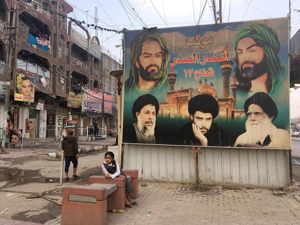 Portraits of Muqtada al-Sadr, his father and father-in-law are painted on a wall in Sadr City, a district of Baghdad. An estimated 4 million people live in Sadr City, known as Saddam City before Saddam Hussein was toppled in 2003.