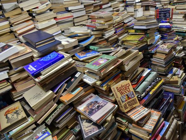 Books stacked in a library. The Romance Writers Association issued a statement earlier this week criticizing their own history of excluding black authors from RITA prizes.