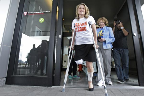 Roseann Sdoia leaves Spaulding Rehabilitation Hospital in Boston in May 2013 after losing part of her right leg in the explosions near the finish line of the Boston Marathon.