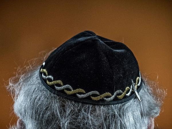 """A Jewish man wears a yarmulke, also called a kippa, during a meeting on """"the German and French perspectives on immigration, integration and identity"""" organized by the American Jewish Committee this week in Berlin."""