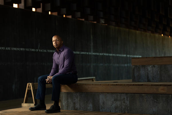 Bryan Stevenson, founder and executive director of the Equal Justice Initiative in Montgomery, sits in a reflective space at the National Memorial for Peace and Justice.