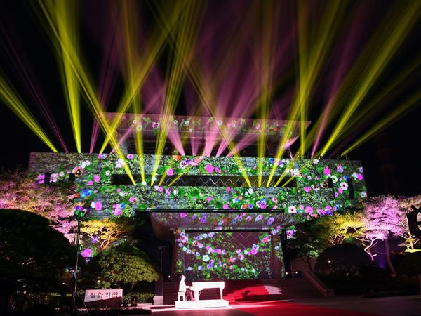An image of flowers is beamed onto the Peace House where the historic summit between the North and South Korean leaders took place, during the closing ceremony.