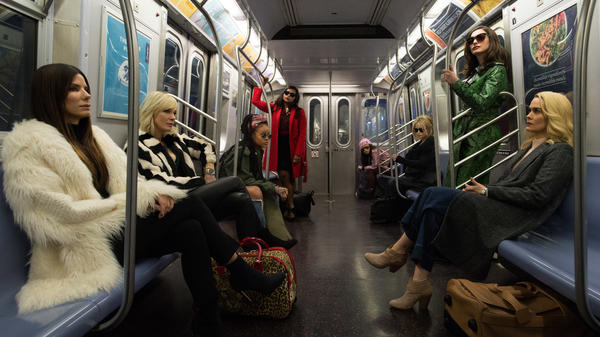 In <em>Ocean's 8</em>, Anne Hathaway (second from right) gets robbed by (left to right) Sandra Bullock, Cate Blanchett, Rihanna, Mindy Kaling, Awkwafina, Helena Bonham Carter and Sarah Paulson.