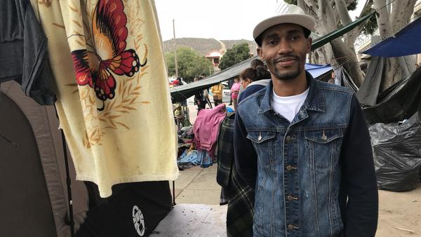 Jean Stevenson Dorvil, originally from Haiti, spent six months trying to reach Tijuana from Venezuela where he had been living. He hopes to be granted political asylum by the United States, but he's been waiting on the Mexican side for the past six months with no word from authorities of his fate.